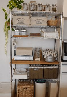 Add solid board to create usable surface on pantry shelf - bar? Also, tidy shelf organization: combo of glass jars, baskets, trays, etc. Kitchen Organization Pantry, Kitchen Shelves, Kitchen Pantry, Diy Kitchen, Kitchen Interior, Kitchen Storage, Kitchen Decor, Wire Kitchen Rack, Shelf Makeover