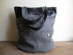 Repurposed+Black+Leather+and+Grey+Wool+Tote+by+TheCOBShop+on+Etsy,+$130.00  Cindy did a custom bag for me from a favorite old leather jacket. She does FABULOUS custom work!!