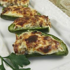 "Sausage Stuffed Jalapenos | ""These are a knockout! The whole family scarfed them up during half-time. """