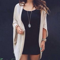 I love a neutral colored cardigan over a black dress.