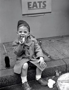Boy eating Hot Dog, 1950, New York, Unknown photographer