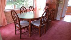 "Dining table (78"" with leaf, 60"" with leaf removed) with 6 dining chairs."