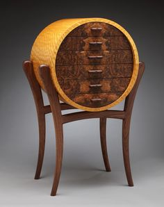 Blase Mathern calls himself the Wood Maestro, and it's easy to see why. His one-off pieces reflect the combination of wood fetishism and craftsmanship that only someone deeply engaged with the material could create. Pieces like his Satin Cirque, above, and Quilted Chamber, below, seem as if they clearly had...