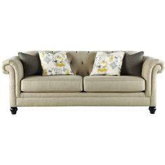 A classic addition to your living room or parlor, this upholstered sofa showcases rolled arms and a button-tufted design.Product: