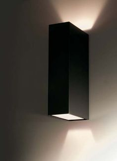 CLV2 Parete-Soffitto Large IP20 rated wall or ceiling lamp for interior use with dual light emission and the possibility of separate switches. it consists of an outer box measuring 100x200x50mm made of either polished aluminium or painted ivory, black or mocha; inside it is painted red, black or ivory. clv2 large is supplied with two G9 lampholdersfor compact low-pressure halogen lamp uvstop 60W-250V or 2x4W 3000K led.