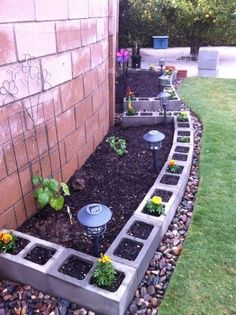 Cinder block edging.   Definitely would look better when in bloom, but not a bad idea.