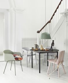 A playful interior design is achieved by combining pastel hues with a white background.