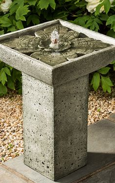 The cast stone Anya Fountain is incredibly durable in all kinds of elements. Water bubbles up from the center onto a charming, intricate leaf at the bottom of the basin before gently trickling into the square tier below.