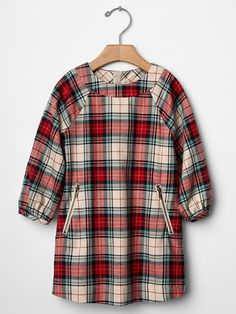 Make sure your little girl is outfitted for the holiday season with this adorable plaid dress!