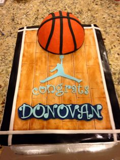 Graduation Cake for a young man who loves basketball.  Vanilla on vanilla.  By Tu-Tu's Cupcakery