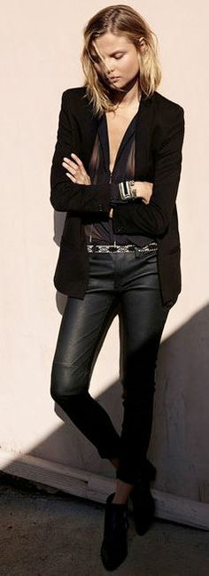 Black leather pants and sheer blouse.