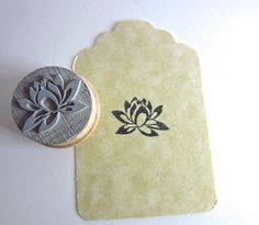 This is for one Lotus rubber stamp at 3/4 round size and mounted on upcycled wood plugs.    Easy to clean with baby wipes and may be used on:    *