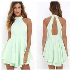 Beautiful Mint Green Dress!!! Sold Out Style!!! This dress is perfect for spring and summer! It has a slit back and buttons at the neck and zips at the back of the waist. There are two layers of flowy material at the bottom and the back is a bit longer than the front. NWOT, never worn, but Lulu's ships items without tags. Juniors size large. Lulu's Dresses Mini