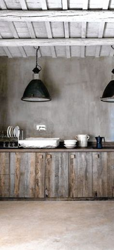 = wood cabinetry and black industrial pendants