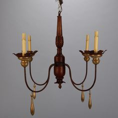 Italian Four Arm Gild Wood and Iron Chandelier  --  Circa 1930s classic Italian style chandelier with wood and iron frame. Four gracefully curved arms with gild wood bobeches, candle style lights and painted wood and metal central shaft. New wiring for US electrical standards.  --   Item:  6557  --  Price:  $1595