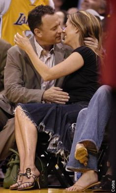 Tom Hanks gives his wife Rita Wilson a courtside kiss.