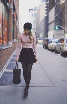 Red striped turtleneck + black suede skirt + tights + boots accessorized with draped necklace + black beanie + tote