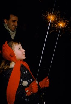 A father and daughter light sparklers in Washington D.C. to celebrate Eisenhower's homecoming.Photograph by Kathleen Revis, National G...