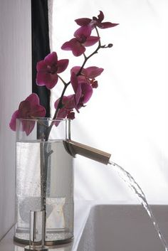 Faucet Flower: It's a beautiful combination of faucet and vase.
