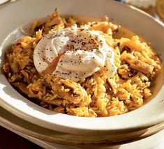 Spiced Rice with Kippers & Poached Eggs—Omit the kippers and use vegetable broth to make this absolutely delicious recipe vegetarian.