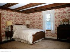 Second bedroom with beautiful toile wallpaper and fireplace. Find this home on Realtor.com