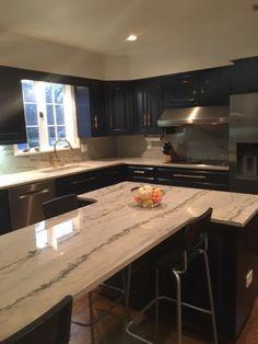 Calacatta Quartzite / White Macaubas quartzite kitchen countertops. What a lovely kitchen island with a waterfalling mitered edge! #quartzite #island #columbia