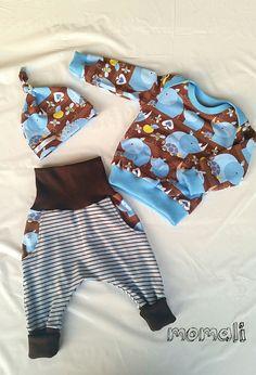 Babyset aus Luckees von NipNaps, Knotenmütze von Klimperklein und Schnabelina Body als Pullover.