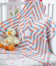 The Shine Bright Star Baby Blanket is as special as any star in the sky. Not only is this crochet baby blanket pattern an ultimate stylish cuddle partner, but it also makes a great play mat.  | AllFreeCrochetAfghanPatterns.com