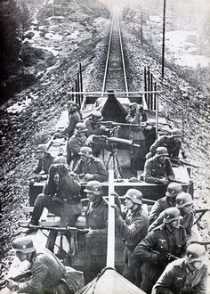 German soldiers on the lockout for partisans on a train, somewhere in the Balkans, note the WWI MG-08 in the center of the picture.