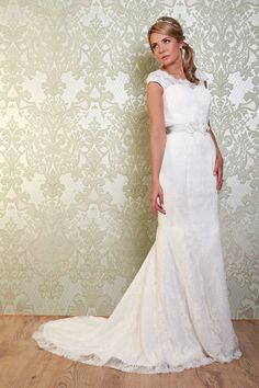 The Page features lace cap sleeves above a detailed, embroidered bodice. https://www.wed2b.co.uk/vintage-wedding-dresses/viva-bride-page.php#
