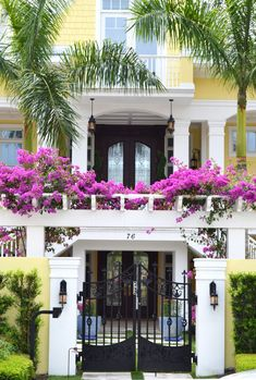 Quintessential Olde Naples with a bougainvillea arbor to top it off.
