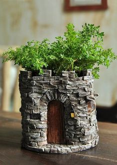 """description~ Forget boring flower pots in your garden. With this fairy castle flower pot, you can turn even the most boring ferns into magical worlds. The pot is designed to look like the base of an old castle. It is features """"stone"""" walls built i. Fairy Garden Supplies, Fairy Garden Houses, Garden Art, Big Garden, Fairy Gardening, Organic Gardening, Garden Ideas, Indoor Gardening, Herb Garden"""