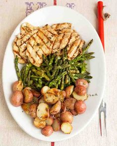 Minced garlic, olive oil, white-wine vinegar, and fresh thyme make a light and flavorful marinade for chicken cutlets. Wrap baby red potatoes in foil to roast on the grill while the chicken cooks.