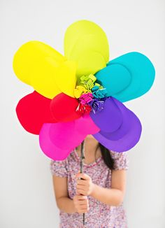 How to Make a Giant Paper Rainbow Flower. Fun spring flower craft for kids!