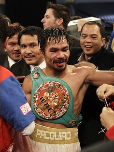 Manny Pacquiao wears the championship belt after his WBC junior middleweight title fight with Antonio Margarito:  http://bit.ly/A6e7pN