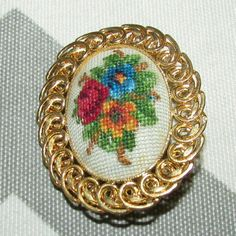 Embroidered Flower Brooch $$OBO$$ Slightly tarnished a little yellowing on front (seen in photo) an inch by an inch and a half  CLOSET CLEAR OUT! Taking all offers as long as they are made using the button! Also bundling for a bargain with 20% off 2 or more! Vintage Jewelry Brooches