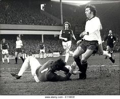 21st February 1976. West Ham goalkeeper Mervyn Day dives at the feet of Derby County striker Kevin Hector at Upton Park.