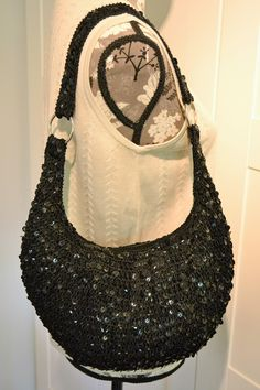 Black Macrame Sequin Shoulder Bag. Get one of the hottest styles of the season! The Black Macrame Sequin Shoulder Bag is a top 10 member favorite on Tradesy. Save on yours before they're sold out!