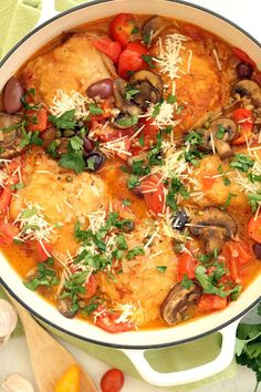 This tasty One Pan Italian Chicken dish features classic Italian ingredients, like tomatoes, olives, capers, mushrooms, parsley, a little vino and some Parmesan cheese. It's a quick chicken dinner you can pull together any night of the week.