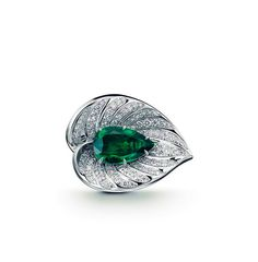 Inedit Joaillier ring with diamonds and emerald