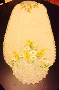 A personal favorite from my Etsy shop https://www.etsy.com/listing/484513219/beige-table-runner-embroidered-table