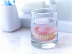 With time, you'll adjust to eating with dentures. - Adam Gault/Caiaimage/Getty Images