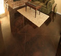 Dark Stained Concrete Floor | finished flooring in basement floors, foyers and living area. Concrete ...