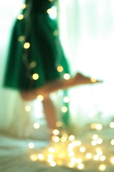 Beautifulll!!! Wrap lights around and turn the picture unfocused and it creates beautiful bokeh:) I do this a lot but just on Christmas trees... Also with a natural light in the back, wonderful contrast with the green dress. Just a great picture!