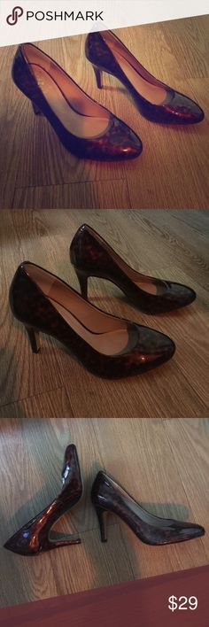 Vince Camuto patent leather leopard shoes sz 36 My adorable mom bought these cute patent leather leopard print Vince Camuto shoes but says she can't deal with how high the heel is (about 2 inches tall), so she never wore them. Don't miss out on these stylish work shoes! Vince Camuto Shoes Heels