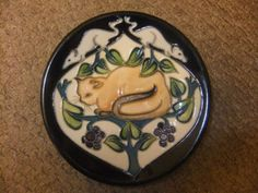 MOORCROFT-RARE-CAT-MOUSE-PLAQUE and like OMG! get some yourself some pawtastic adorable cat apparel!