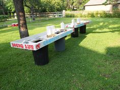 crawfish tables, holes in the table, trash barrels for the table legs