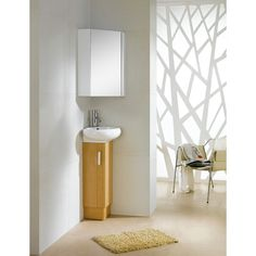 Update your bathroom decor with this Milan yellow oak and white vanity. This wooden vanity has a wall mount construction to keep your interior decor elegant and unique.