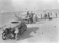MINISTRY INFORMATION FIRST WORLD WAR OFFICIAL COLLECTION (Q 24401) Armoured cars salving a British plane which was captured from the Germano-Turk aerodrome at Tekrit.