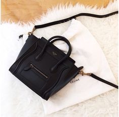Black Nano Luggage Céline Bag. Designed with the recognizable Céline trademark, this bag is made for the show-offs.